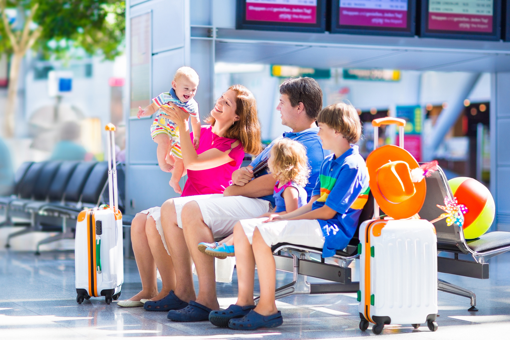 Beautiful young family at the airport | sense organics - fair trade baby clothes
